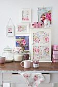 Cabinet and pictures of roses decorating shabby-chic kitchen table