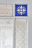 Vintage interior door with blue stained and patterned glass panels