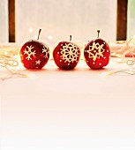 Red Christmas apples decorated with icing