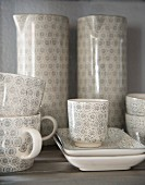 Cups and jugs with pale grey retro pattern