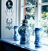 Blue and white painted Chinese vases on windowsill