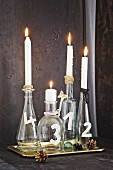 Advent wreath made from festively decorated glass bottles and candles