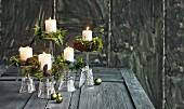 Upturned stemmed glasses used as festive candlesticks