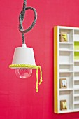 Simple pendant lamp with white lampshade decorated with neon yellow crocheted trim