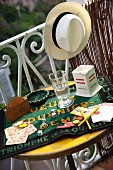 Playing cards and dice on retro balcony table
