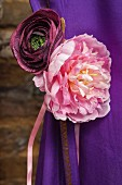 Pink and purple fabric flowers on purple sari