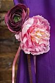 Pink and purple fabric flowers on purple sari