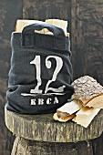 Hand-sewn hessian bag of logs