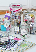 Sewing utensils in mason jars with labelled tags hand made from modelling compound