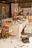 Table festively set for wedding with vintage, curved metal chairs