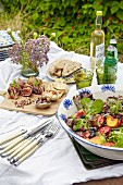 Summer buffet of nibbles and drinks on outdoor table
