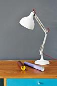 White anglepoise lamp on desk