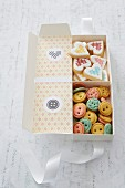 Biscuits shaped like buttons and love-hearts in gift box