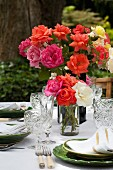 Summery table set with flowers outdoors