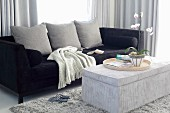 Elegant, black velvet sofa and cord velvet ottoman