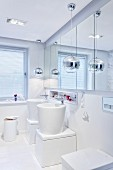 Designer bathroom: extravagant washstands below mirrored cabinet on wall and pendant lamps with spherical chrome lampshades