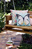 Decorative scatter cushions on DIY swing bench