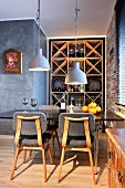 Retro dining area in front of wine rack in niche