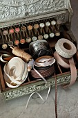 Vintage cash register used to store sewing utensils