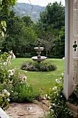 Stone fountain in large garden