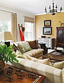 Striped sofas in Colonial-style living room in shades of brown