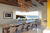 Enormous dining table in modern interior with panoramic window