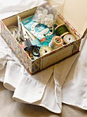 Sewing supplies in box with retro pattern