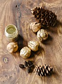 Walnuts, various pine cones and jar of gold powder