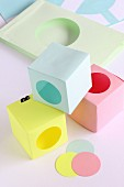 Hand-crafted paper boxes with punched, circular openings
