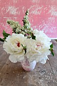 Bunch of white peonies with red centres