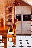 Rustic, Medieval-style solid-wood dining set on tiled floor with dark accent tiles