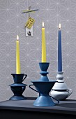 Hand-crafted candlesticks made from old china crockery painted and stuck together