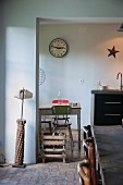 Vintage standard lamp next to wide, open doorway with view of kitchen table