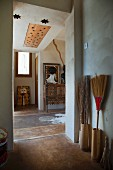 Bungalow foyer with painted floor and collection of besom brooms