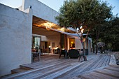 Wooden terrace of Mediterranean bungalow at twilight