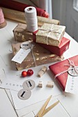 Christmas gifts wrapped in gold and red with labelled tags