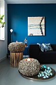 Blue wall and coral-shaped ornaments in living room