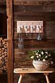 DIY key rack with love-heart ornaments on wooden wall