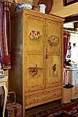 Old farmhouse wardrobe painted with animal motifs