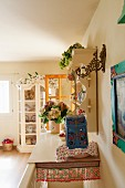 Head of staircase covered with shelf and flower arrangements on romantic plate rack and display cabinet
