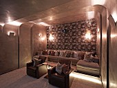 Rounded wall and ceiling cladding in elegant home cinema with upholstered seating, collection of cushions and atmospheric lighting