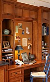 Solid-wood fitted cabinets with shelves and integrated desk in country-house style