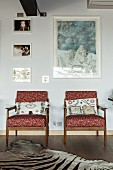 50s armchairs with Missoni covers below framed pictures on wall