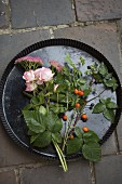 Climbing rose, fat hen (sedum), rose hips, sloes and sprig of blackberries in flan tin