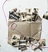 Festive arrangement of old black and white family photos, ribbon and wrapping paper