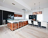 Kitchen counter and dining table in modern, open-plan kitchen-dining room