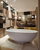 Masculine bathroom with free-standing bathtub and chequered wall tiles