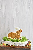 Easter lamb cake in nest decorated with sugar flowers & fondant icing