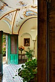 View into foyer with painted, vaulted ceiling in Villa Cimbrone in Italy