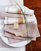 Linen napkins with delicate napkin rings made from cherry wood
